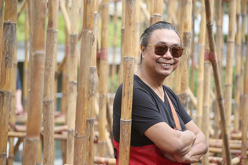 Artist Rirkrit Tiravanija with his bamboo maze installation on the roof garden of National Gallery Singapore last year.