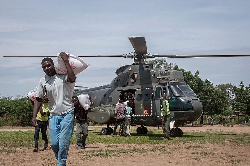 Relief supplies being delivered to parts of southern Malawi last Friday. Cyclone Idai has killed at least 56 people in the country. People inspecting the damage after Cyclone Idai made landfall in central Mozambique last Saturday. More than 1,000 peo
