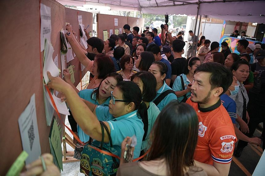 Thais looking for their names at a voting centre in the Bangkapi district of Bangkok during early voting on Sunday. There was an 86.98 per cent turnout among the 2.6 million early voters registered, Mr Ittiporn Boonpracong, chairman of the Election C