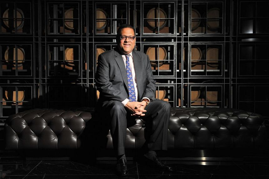 Former central bank chief Arjuna Mahendran is wanted back in Sri Lanka for his role in a high-profile US$74 million insider trading scam.