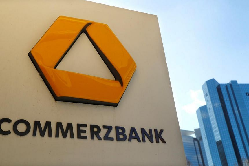 A sign at an ATM of Commerzbank next to the headquarters of Deutsche Bank in Frankfurt, Germany, on March 19, 2019.
