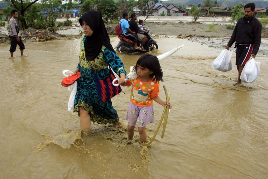 Flash floods and landslides in Indonesia's Papua region were triggered by heavy rain on March 16, 2019.