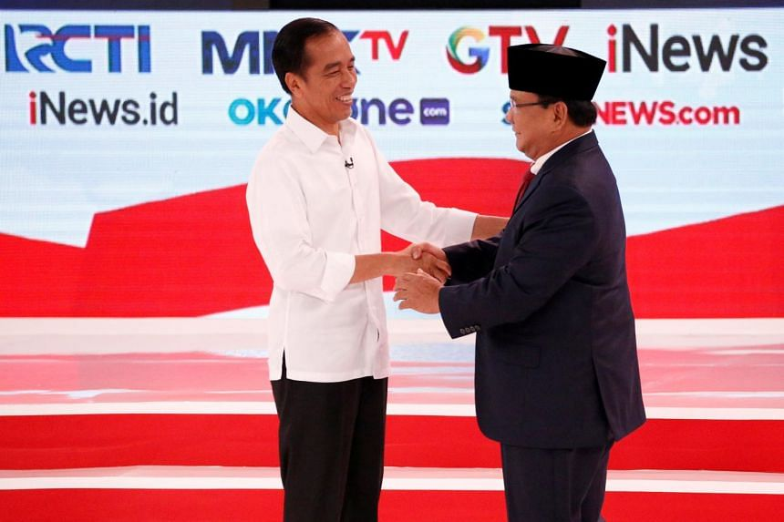 Indonesian President Joko Widodo (left) and Mr Prabowo Subianto shake hands after the second debate between presidential candidates, on Feb 17, 2019.