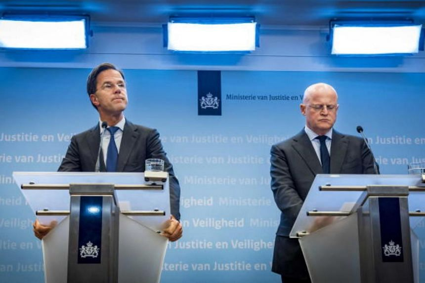 Dutch Prime Minister Mark Rutte (left) and Minister for Justice and Security Ferd Grapperhaus speak to the press following a shooting in Utrecht, The Netherlands on March 18, 2019.