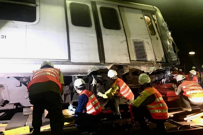 Engineers inspect the wreckage of an MTR train after it collided with another during a test run inside a tunnel in Hong Kong.