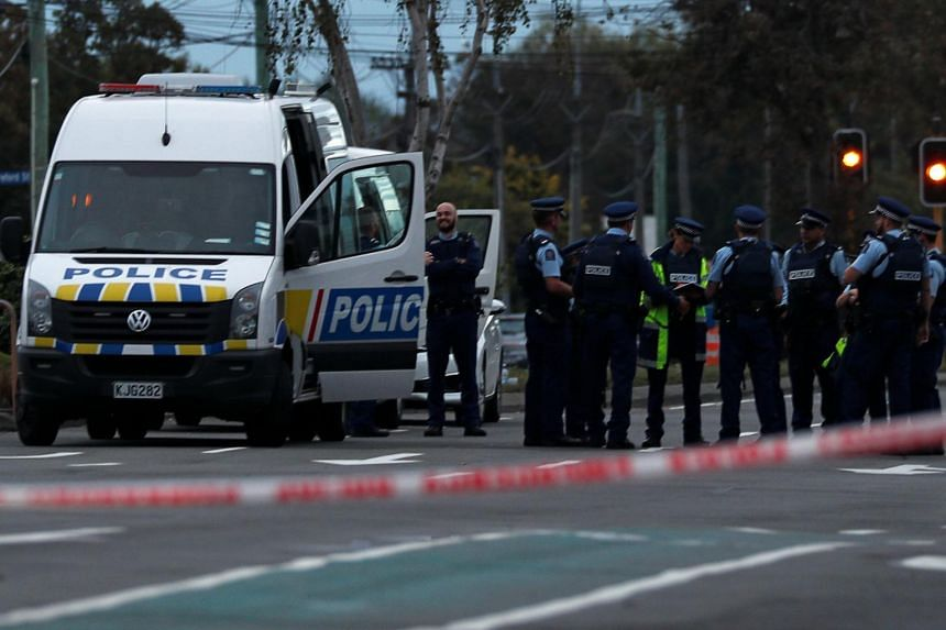 Police officers gather outside Linwood mosque after shootings in Christchurch, New Zealand, on March 16, 2019.