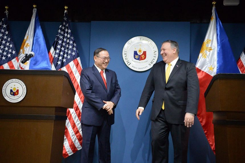 Philippine Foreign Secretary Teodoro Locsin Jr with US Secretary of State Mike Pompeo after their joint press conference at the foreign affairs office in Manila on March 1, 2019.