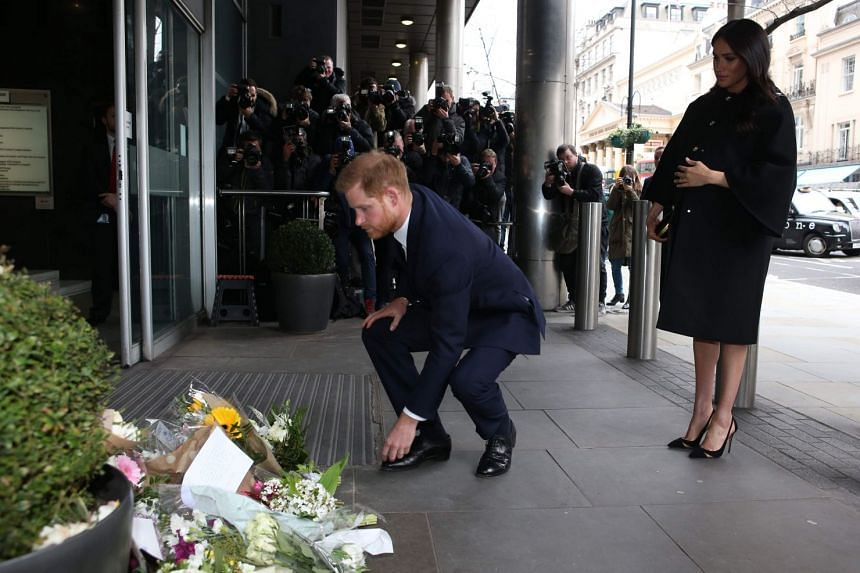 Harry and Meghan add their flowers to floral tributes at the New Zealand High Commission in London.
