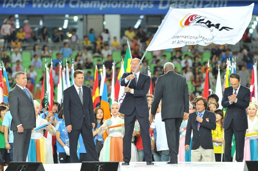 Valentin Balakhnichev waves the IAAF flag during an event in France in 2011.