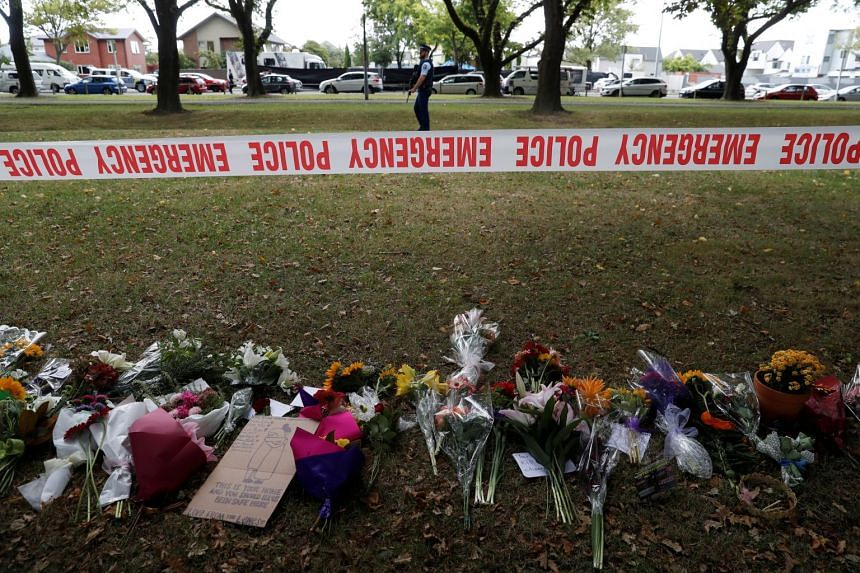 Flowers and signs at a memorial as a tribute to victims of the Christchurch mosque attacks, on March 16, 2019.