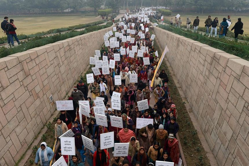 Women hold placards during the Women Dignity march in New Delhi, following the gang rape of student Jyoti Singh, on Dec 16, 2012.