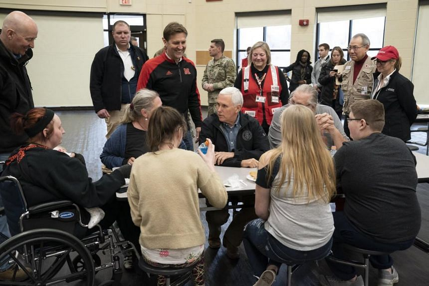 Vice-President Mike Pence visiting flood victims and volunteers at the relief shelter at Elkhorn Middle School.