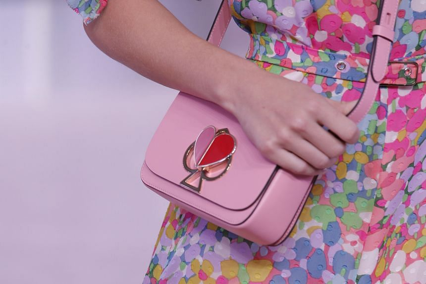 Nicola Glass' first collection for Kate Spade includes flowing satin pieces sporting puff sleeves and subtle ruffles, cropped knits and crossbody bags with spade-shaped twist locks.