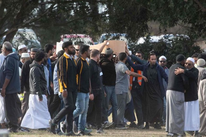 Mourners proceed with the coffin of a shooting victim, slain by an Australian gunman who went on a killing spree at two mosques, at the Memorial Park cemetery in Christchurch on March 20, 2019.