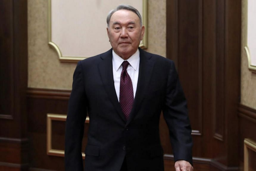 Former President of Kazakhstan Nursultan Nazarbayev (centre) walks during a swearing-in ceremony as Kassym-Jomart Tokayev is sworn in as Kazakh acting president at a joint session of the houses of parliament in Astana, Kazakhstan on March 20, 2019.