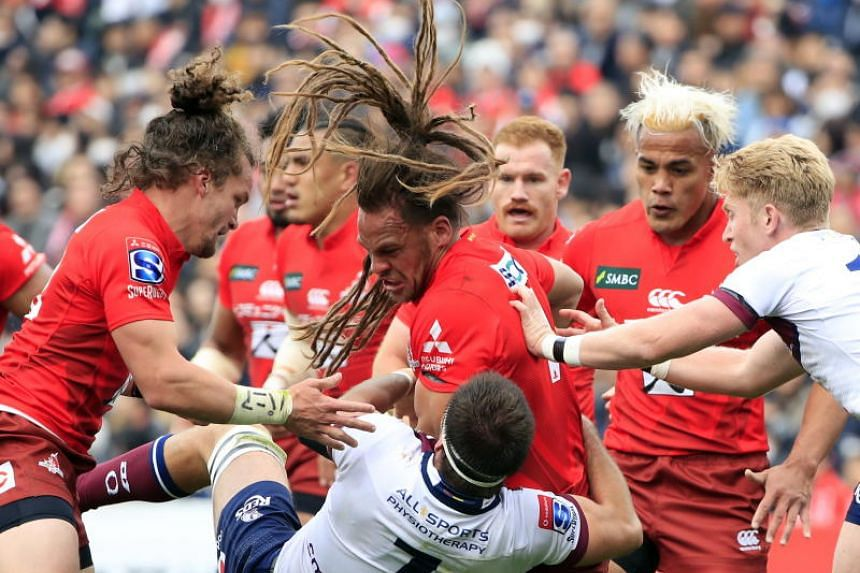 Dan Pryor (centre) of the Sunwolves battles to keep the ball during the Round 5 Super Rugby match between Japan's Sunwolves and Australia's Queensland Reds at Prince Chichibu Memorial Stadium in Tokyo on March 16, 2019.