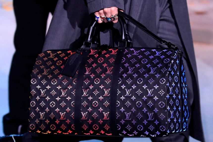 A model presents a creation by designer Virgil Abloh as part of his Fall/Winter 2019-2020 collection for Louis Vuitton.
