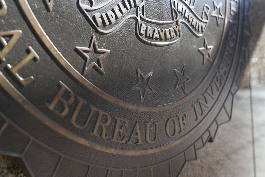 The FBI crest is seen on the outside of the J. Edgar Hoover FBI Building in Washington.