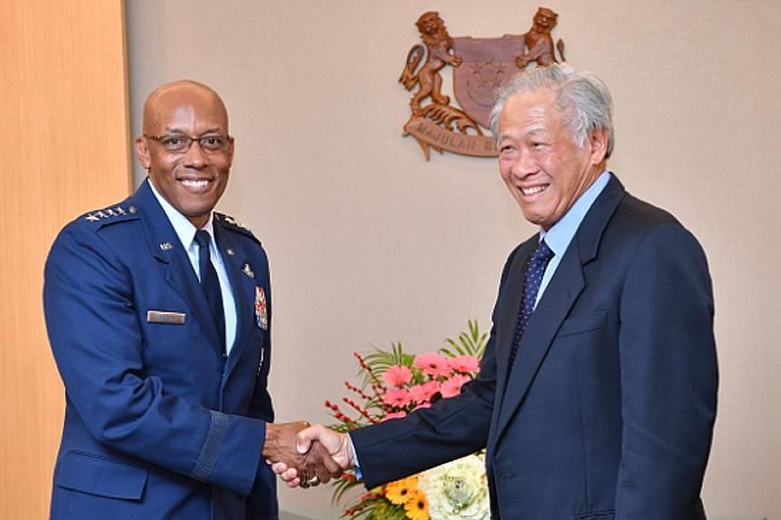 Commander of the United States Pacific Air Forces, General Charles Q. Brown Jr, meeting Defence Minister Ng Eng Hen yesterday.