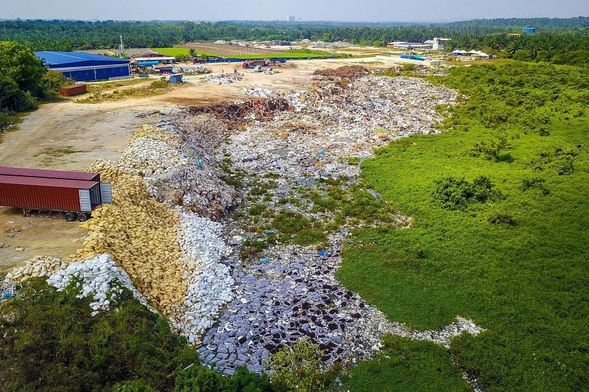 Shortly after the authorities found chemical waste dumped in an oil palm estate in Bukit Teh (above) in Penang, a sprawling illegal plastic dump site was discovered nearby.