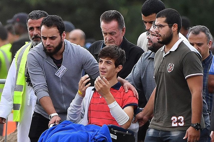 "Zaid Mustafa, 13, the son and brother respectively of massacre victims Khaled and Hamza Mustafa, attending their funeral at the Memorial Park Cemetery in Christchurch yesterday. ""I should be lying beside you,"" the injured boy was heard saying at thei"