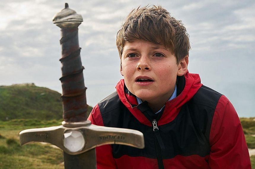The Kid Who Would Be King stars Louis Ashbourne Serkis (top) as Alex, whose life changes when he pulls out a sword from a stone and awakens an evil sorceress, played by Rebecca Ferguson (above).