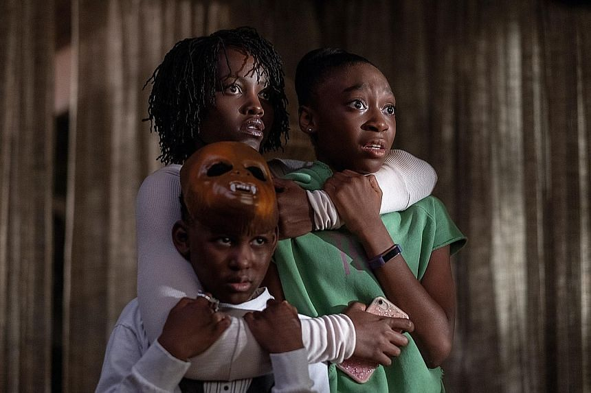 Us stars (clockwise from top) Lupita Nyong'o, Shahadi Wright Joseph and Evan Alex, who play a family terrorised by their doppelgangers.