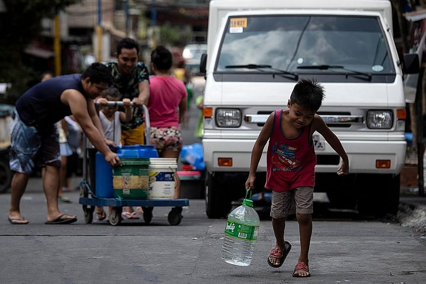 Metropolitan Manila has been hit by a water crisis, with families forced to wait for hours to get supplies from tanker trucks.
