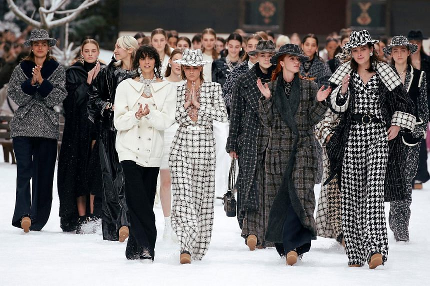 Cara Delevingne and other models react while presenting creations by late designer Karl Lagerfeld as part of his Fall/Winter 2019-2020 women's ready-to-wear collection show for fashion house Chanel during Paris Fashion Week in Paris, France on March