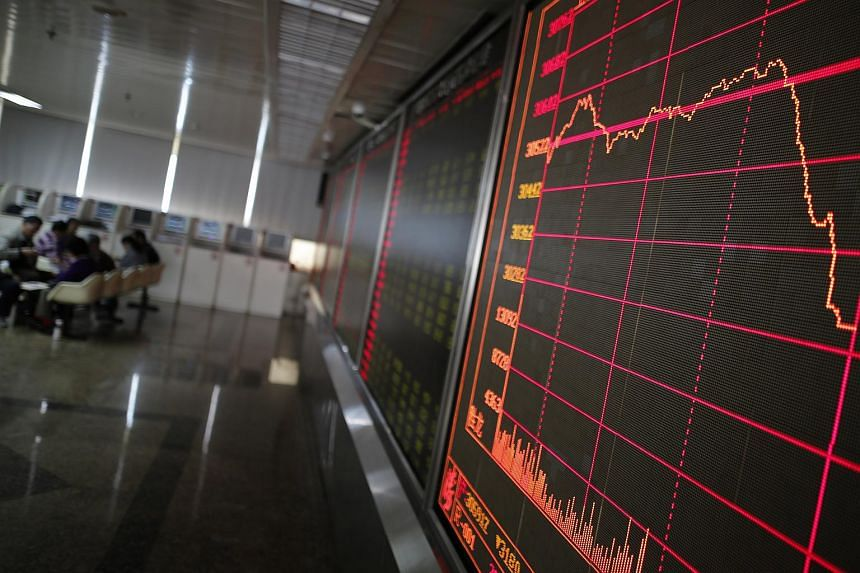 An electronic board displays the stock index at a securities brokerage house in Beijing, China on March 20, 2019.