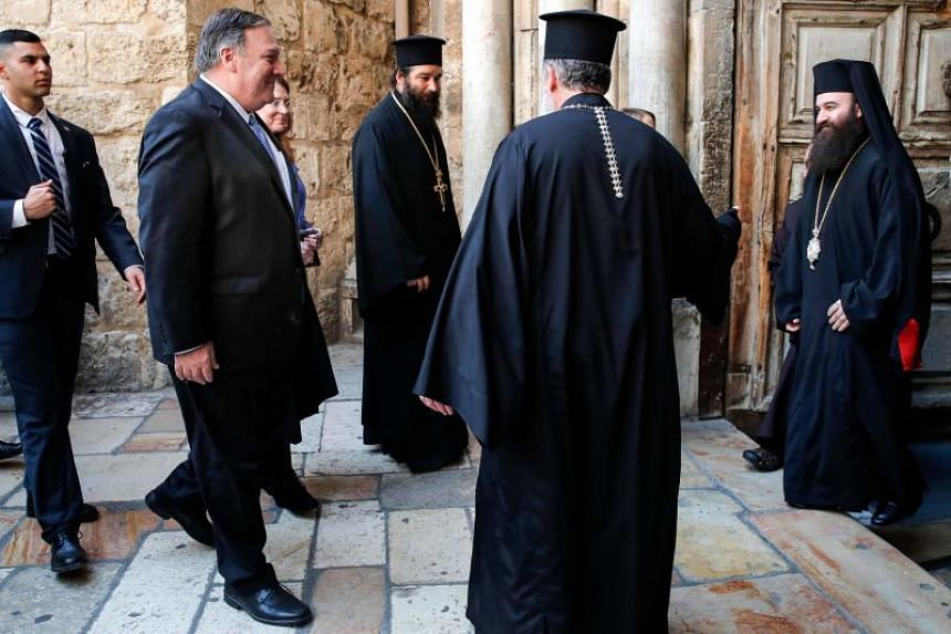 US Secretary of State Mike Pompeo (second from left) is greeted by Orthodox Christian clergymen as he visits the Church of the Holy Sepulchre in Jerusalem's Old City on March 21, 2019.