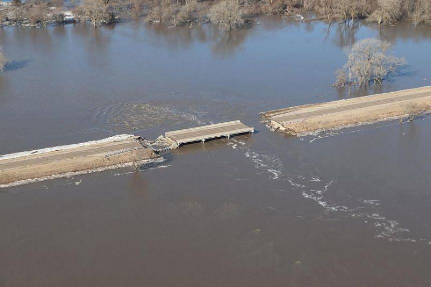 A bridge damaged by flood waters near Genoa, Nebraska, on March 18, 2019.