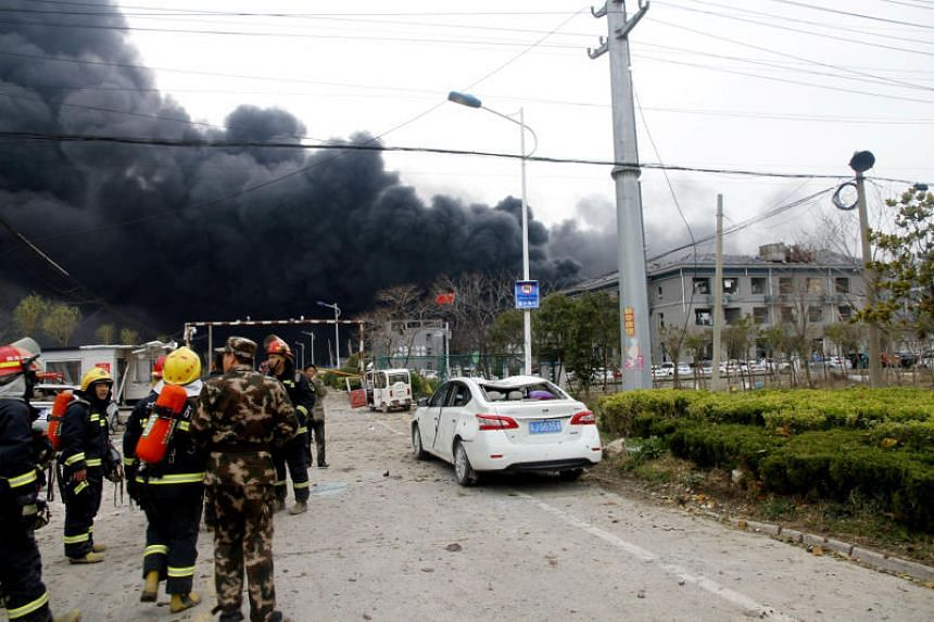 Rescue workers are seen near smoke following an explosion at a chemical industrial park in Xiangshui county, Yancheng, Jiangsu province, China.