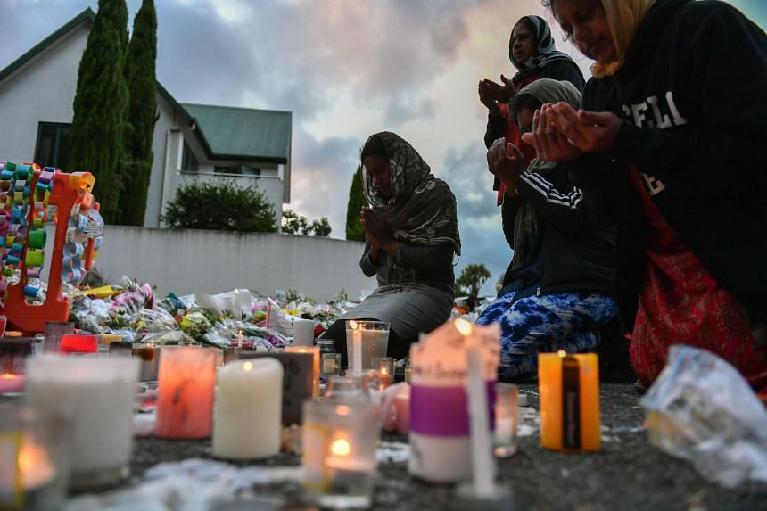 Mourners pray at a makeshift memorial at the Al Noor Mosque on Deans Road in Christchurch, New Zealand, on March 19, 2019.
