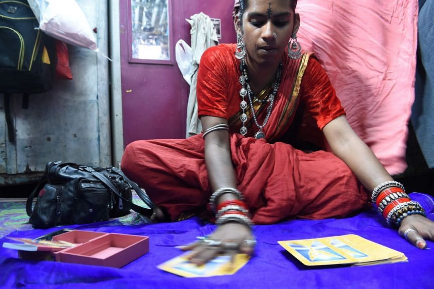 Indian transgender mystic Zoya Lobo shuffles her 'oracle' cards during an interview with AFP in Mumbai, India, on March 18, 2019.