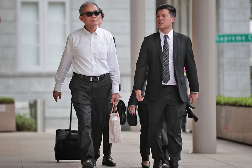Former Ipco International interim chief executive Goh Hin Calm (far left) arriving at the Supreme Court with his lawyer Adrian Wee yesterday.