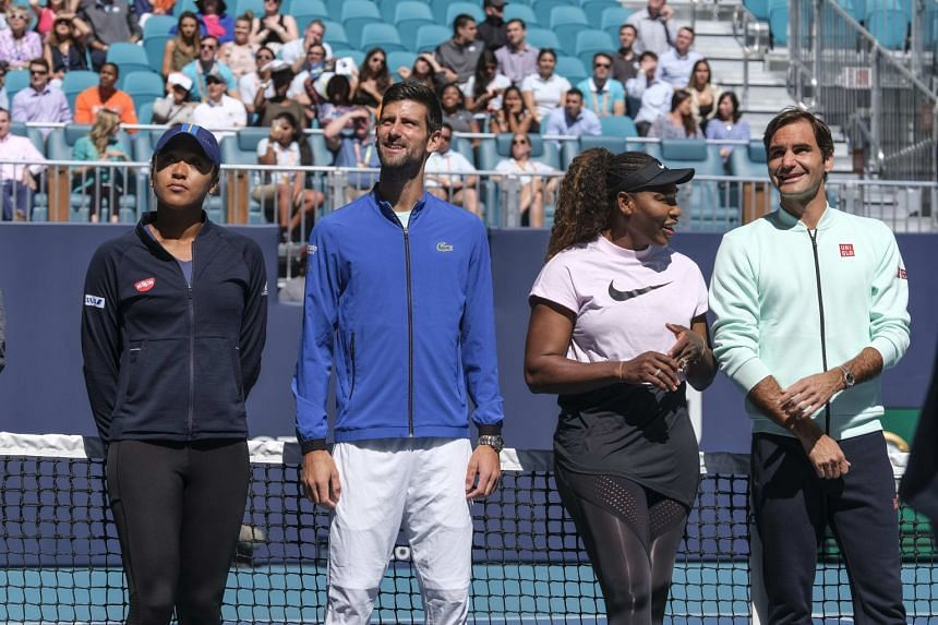 Players (from left) Osaka, Novak Djokovic, Serena Williams and Roger Federer take part in a ribbon-cutting ceremony for the Miami Open Tennis Tournament at Hard Rock Stadium.