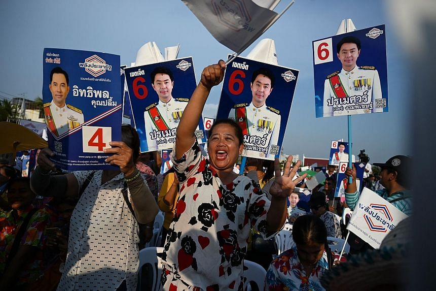 Supporters of Palang Pracharath Party attending a campaign rally in Thailand's Chonburi province yesterday.