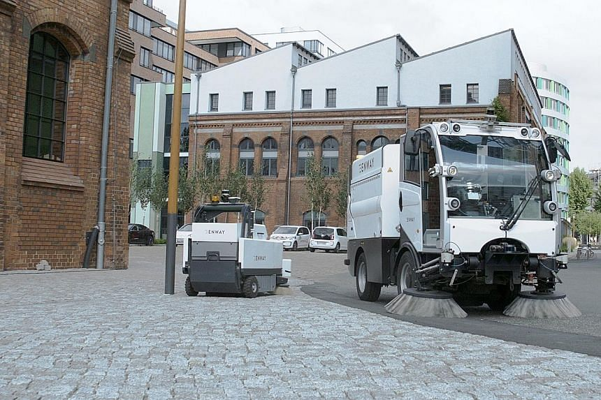 An autonomous road-cleaning vehicle developed by German start-up Enway. The company is part of a four-party consortium - which includes NTU, environmental service firm Veolia and local firm Wong Fong Engineering Works - which will be developing and t
