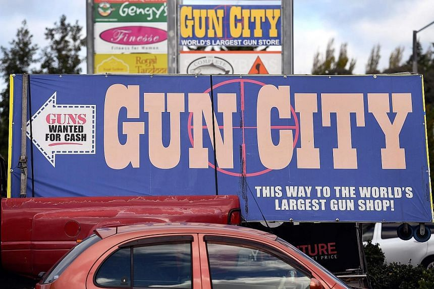 A sign for a Christchurch gun shop. Following the massacre of 50 people at two mosques in the city last week, the New Zealand Cabinet has agreed in principle to overhaul gun laws. More Americans die from guns every 10 weeks than died in the entire Af
