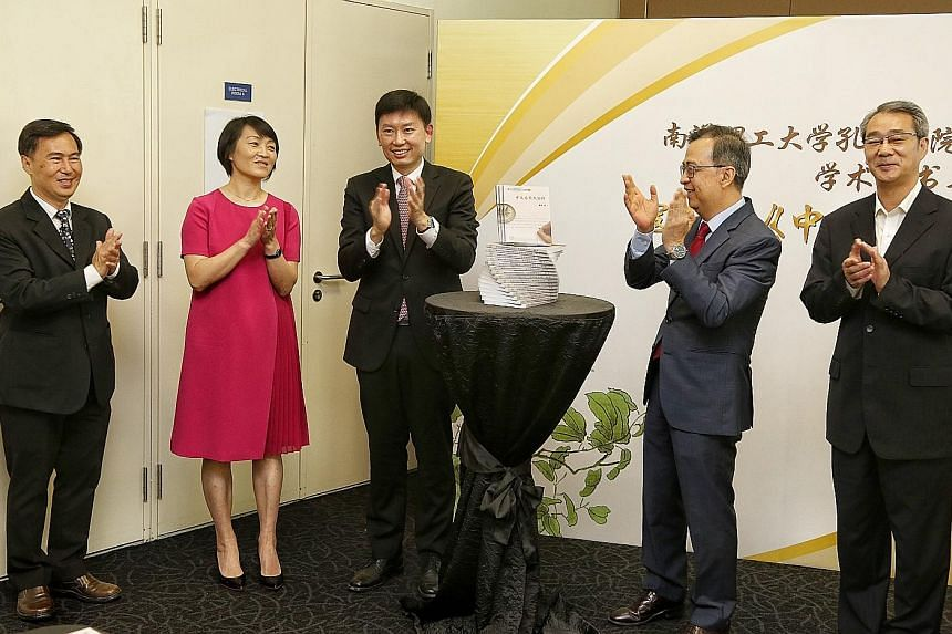 At the launch event yesterday were (from left) Confucius Institute director Neo Peng Fu; Associate Professor Kou Hong, who wrote the book; Senior Minister of State for Trade and Industry Chee Hong Tat, who was guest of honour; Nanyang Technological U