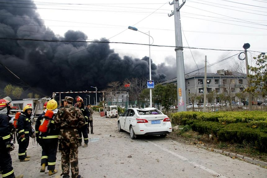 Rescue workers are seen near a factory following an explosion at a chemical industrial park in Xiangshui county, Yancheng, Jiangsu province, China, on March 21, 2019.
