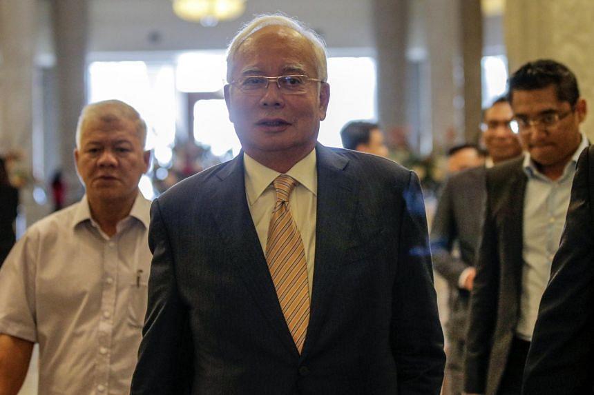 Former Malaysian Prime Minister Najib Razak (centre) leaves the High Court in Putrajaya, Malaysia, on March 21, 2019.