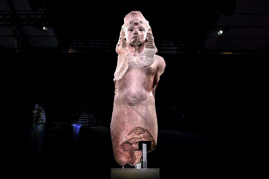 A sculpture of 'Tutankhamun usurped by Horemheb', on display at La Villette in Paris on March 21, 2019.