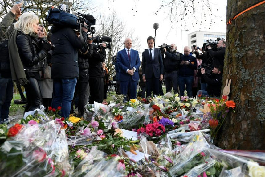 Dutch Prime Minister Mark Rutte and Minister of Justice and Security Ferdinand Grapperhaus place flowers at the site of a tram shooting in Utrecht, Netherlands, on March 19, 2019.