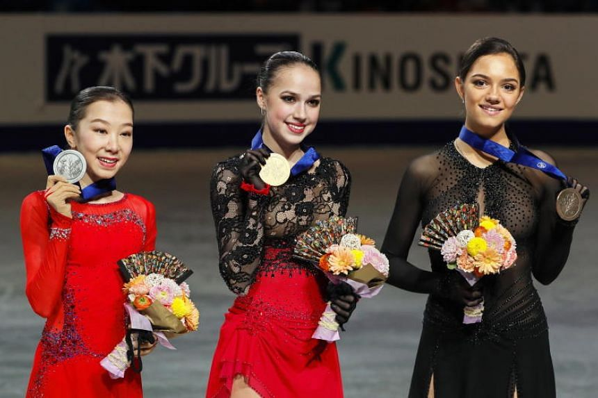 Alina Zagitova (centre) of Russia poses with her gold medal on the podium after winning the Women's Singles event of the 2019 ISU World Figure Skating Championships in Saitama, Japan, on March 22, 2019.