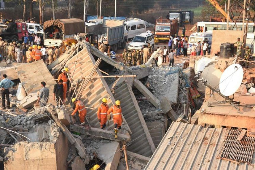 Rescuers searching for survivors on March 20, 2019, after a building collapsed in the Dharwad district of Karnataka.
