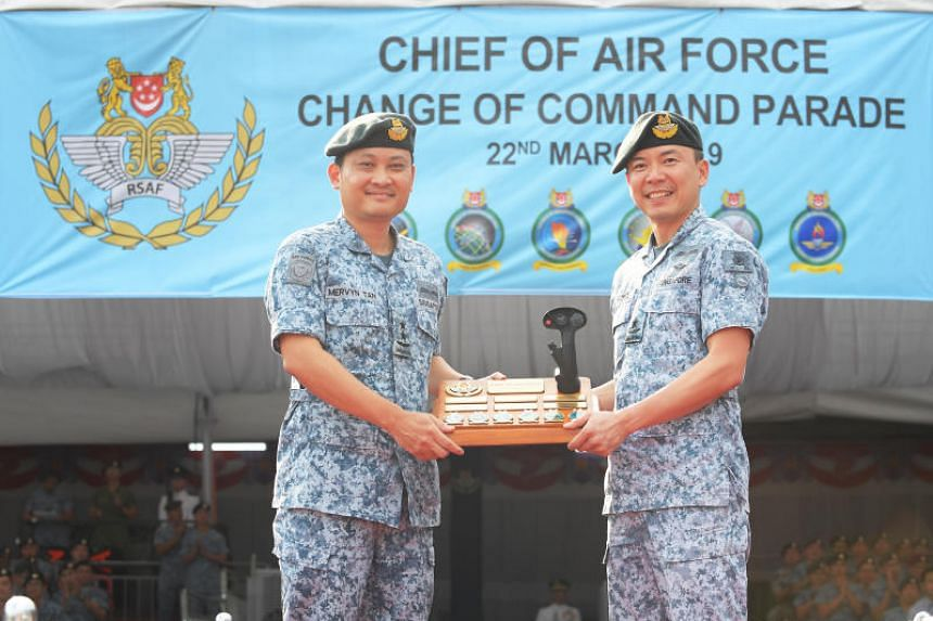 Outgoing Chief of Air Force, Major-General Mervyn Tan (left), handing over command of the RSAF to Brigadier-General Kelvin Khong on March 22, 2019, at Paya Lebar Air Base.