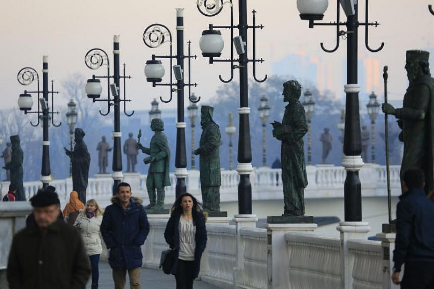 Statues of poets, musicians and artists line the Bridge of Art in the North Macedonian capital of Skopje.