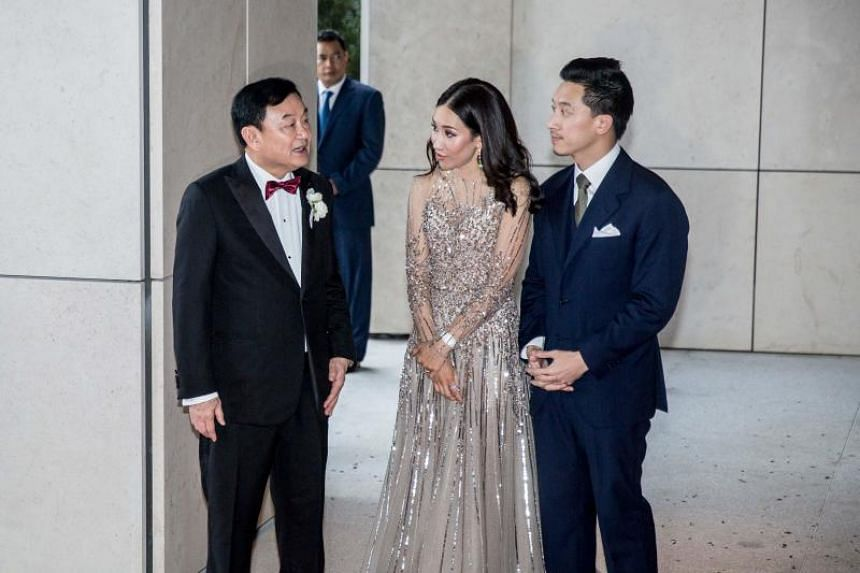 Former Thai prime minister Thaksin Shinawatra (left), his daughter Pintongta Shinawatra and her husband Pong Kunakornwong waiting for guests to arrive on March 22, 2019.